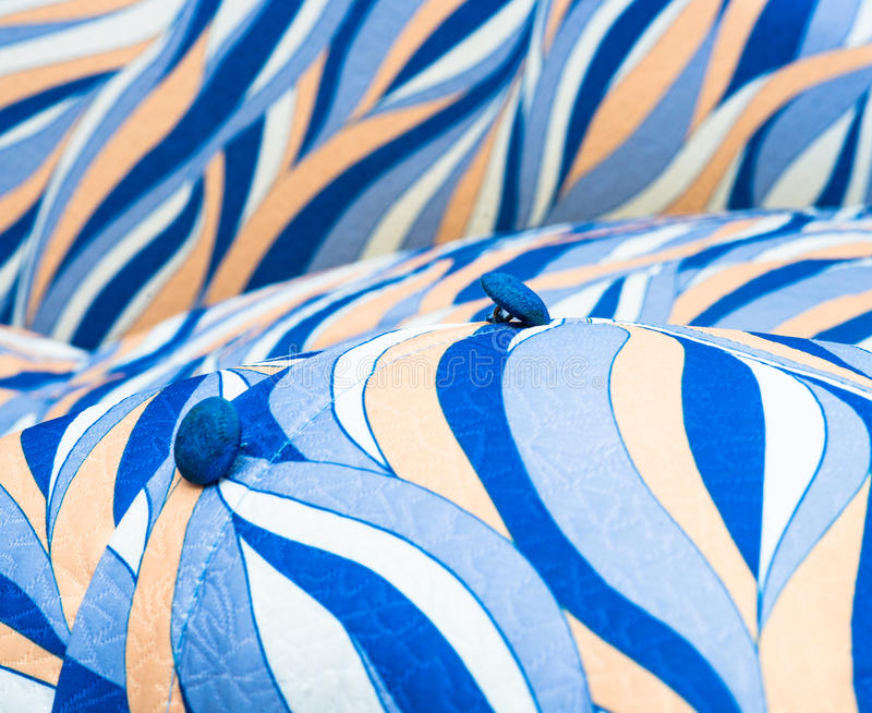 Colored pillow with a button royalty free stock image