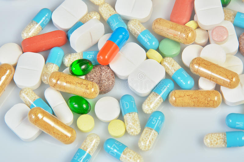 Download Colored Pills  On White Background Stock Photo - Image: 83702359