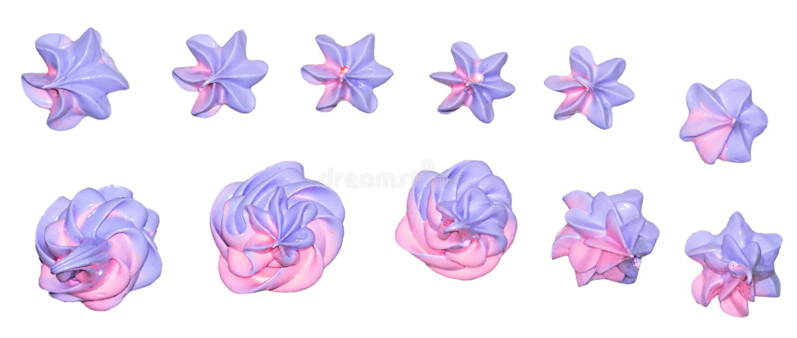 Colored pink and marshmallow marshmallows in the shape of a flower for decoration of a festive dessert on an isolated white backgr. Ound royalty free stock image