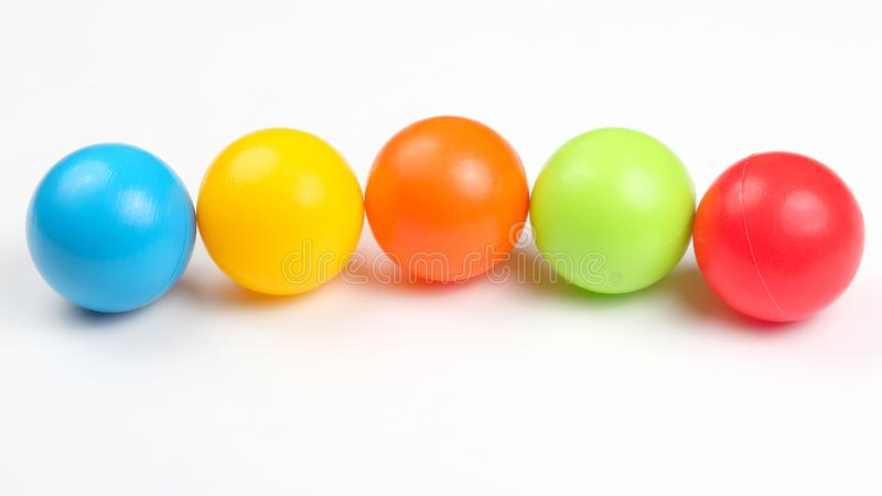 Colored plastic balls on white background. The Colored plastic balls on white background royalty free stock photography