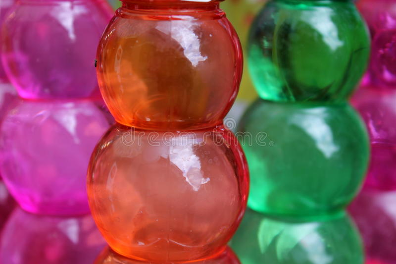 Colored plastic bottles stock images