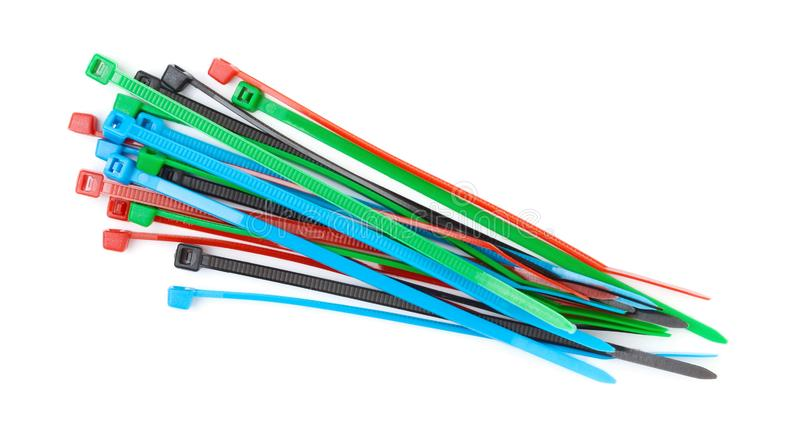 Colored plastic cable ties. Plastic clamps on a white. Background royalty free stock images