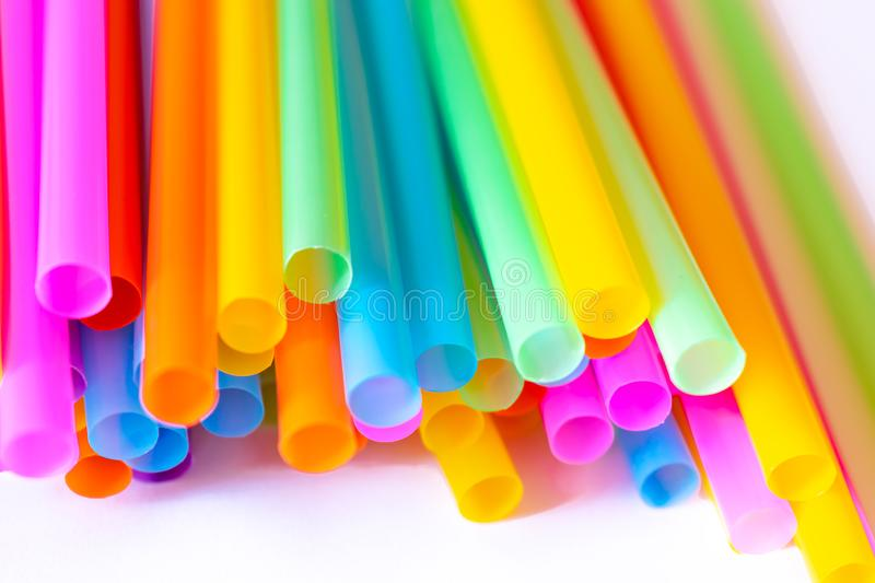 Colored plastic drinking straws on a white background stock images