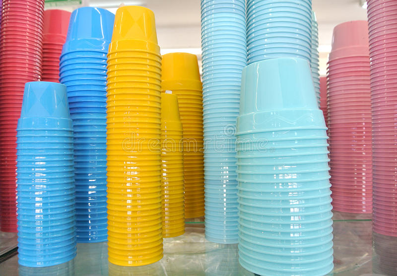 Colored plastic glasses stock images