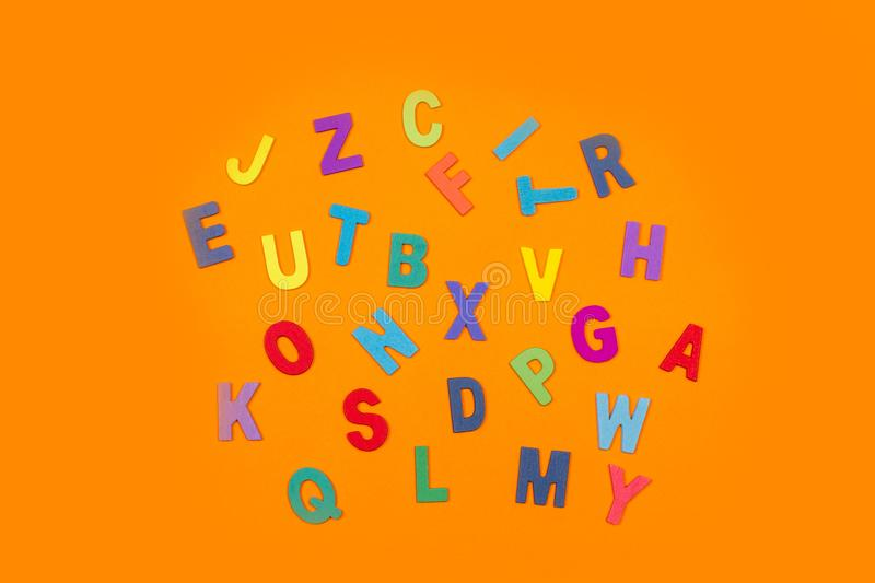 Colored letters on an orange background stock images