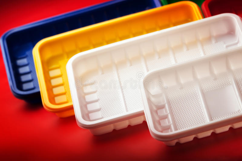 Download Colored Plastic Plates On Red Background Stock Image - Image of disposable containers & Colored Plastic Plates On Red Background Stock Image - Image of ...