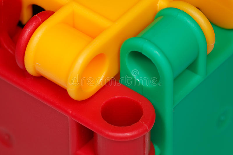 Colored plastic toys closeup. Elements of design stock images