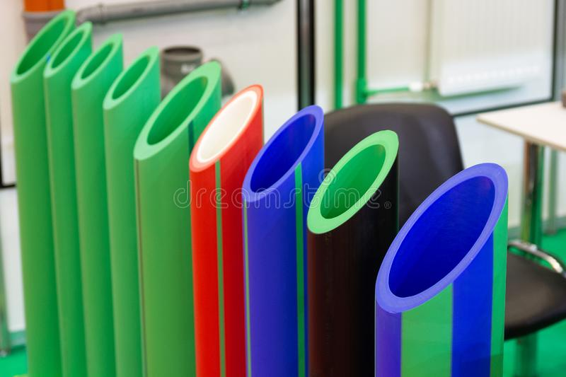 Colored plastic water pipes in the store royalty free stock photo