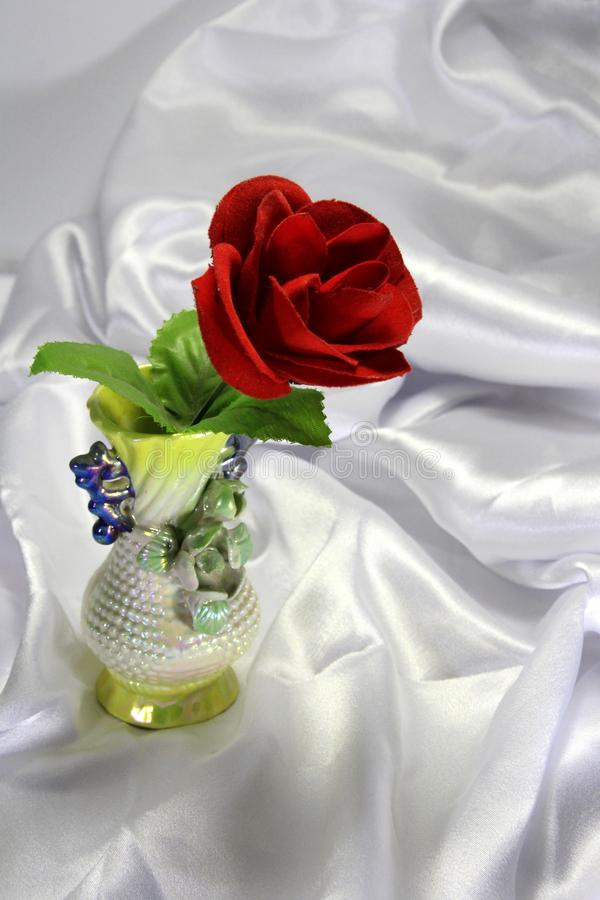 Colored porcelain vase with a red rose royalty free stock photos