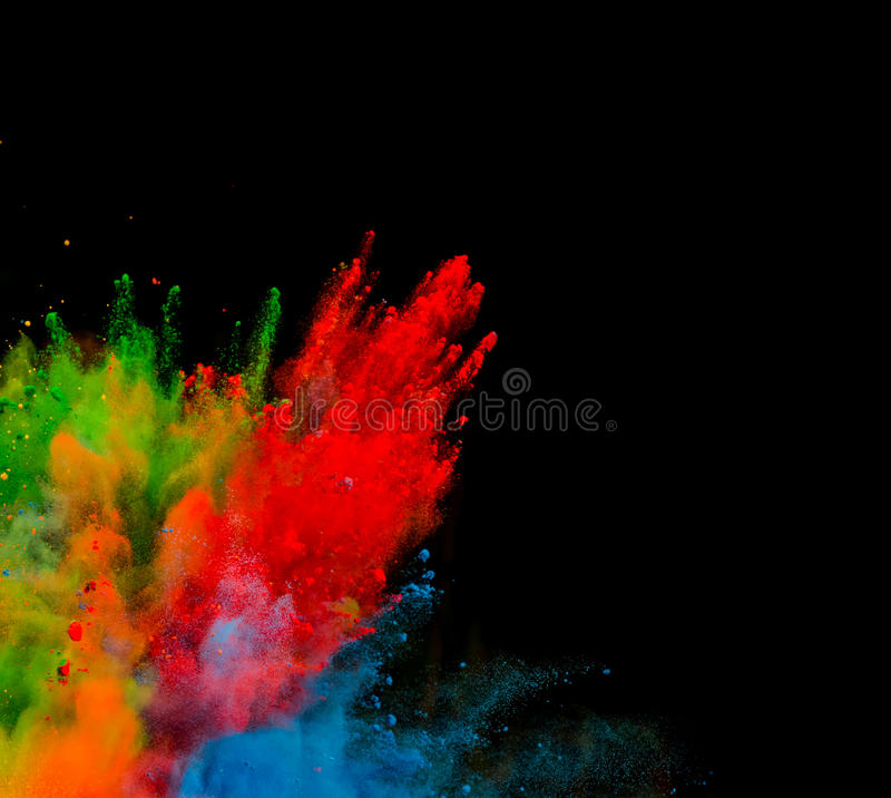 Colored powder on black background stock images
