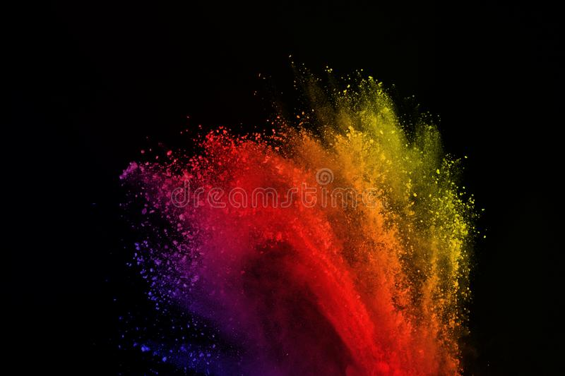 Colored powder explosion. Colored dust splatted. Freeze motion of colored powder explosion isolated on black background. Abstract of colorful dust splatted royalty free stock image