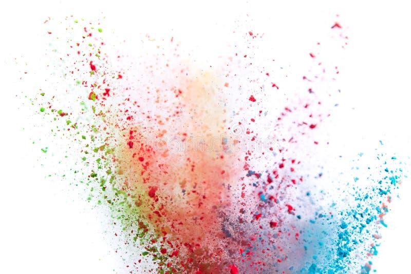 Colored powder explosion on white background. Freeze motion stock image