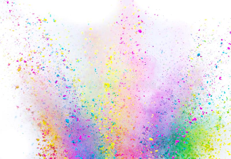 Colored powder explosion on white background. Freeze motion stock images