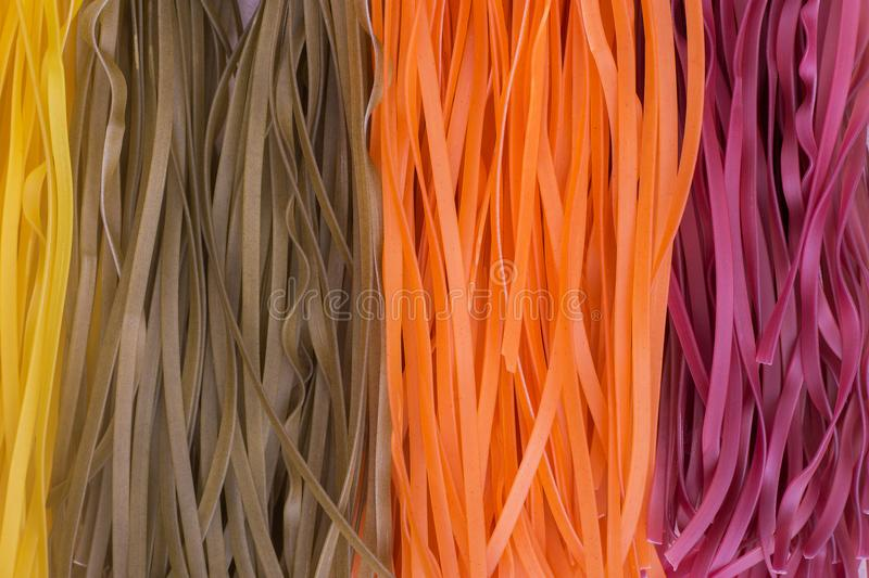 Colored raw vegetable vegetarian pasta royalty free stock images