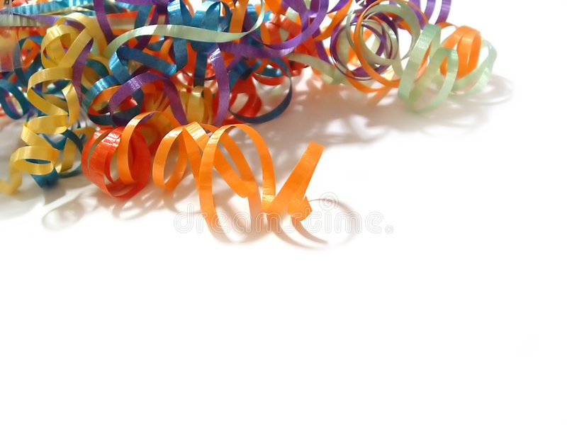 Colored Ribbons. Colored curling ribbons in the corner of a white background royalty free stock photography