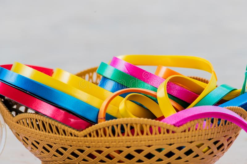 Colored ribbons in rolls on a basket. stock photography