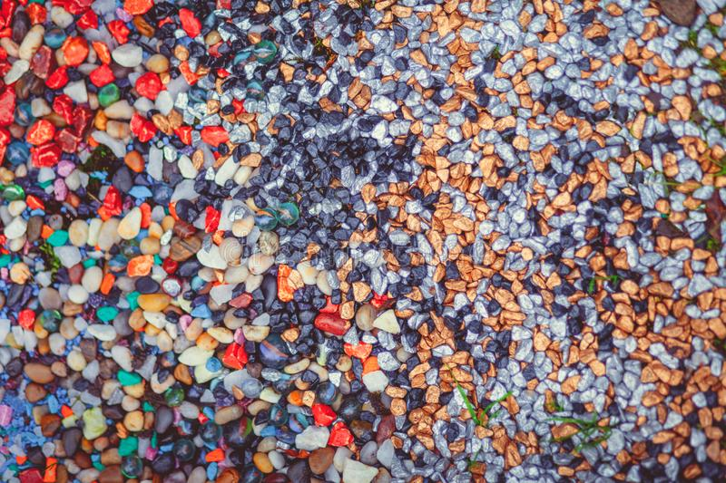 Colored river stones background wallpaper stock images