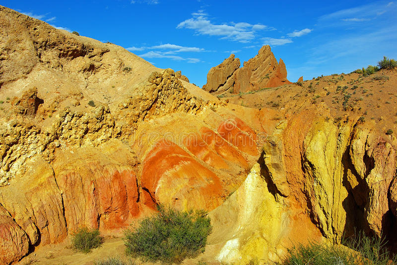 Colored rock canyon tale. Colorful canyon tale in Kyrgyzstan, view on the colored rock royalty free stock photography