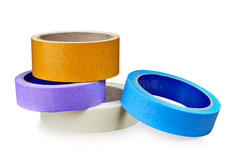 Colored rolls of paper and plastic duct tape on white. stock photos