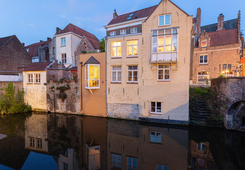 Colored romantic houses by the canal in the historic city center of Brugge stock images