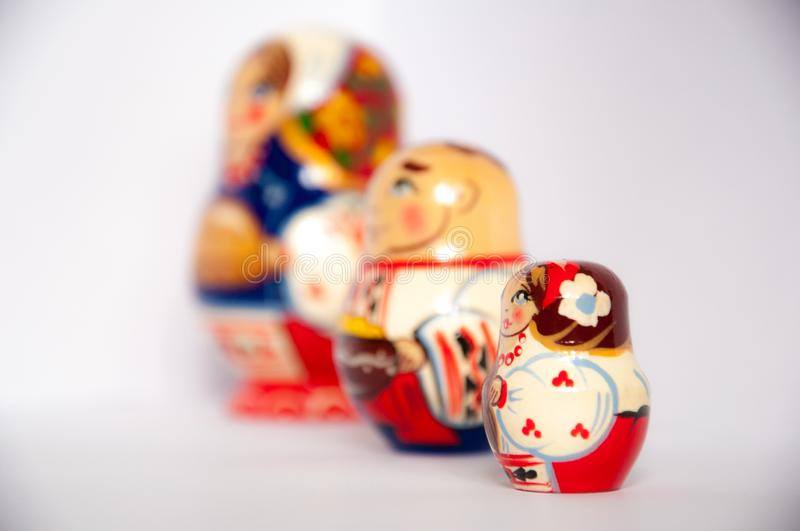 Colored russian matrioshka dolls on grey isolated background royalty free stock photography