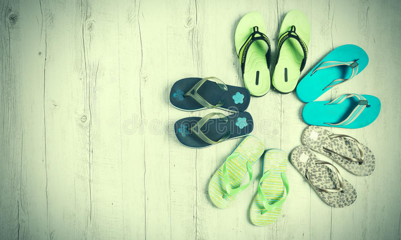 Colored sandals on a wooden background, summer concept royalty free stock image