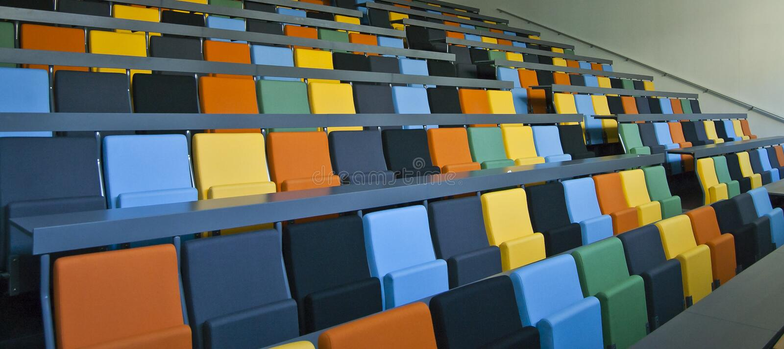 Colored seats. Seats in different colors in a danish auditorium stock photos