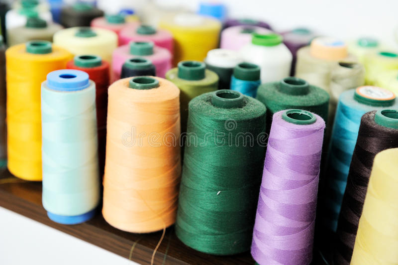 Colored sewing spool stock photos
