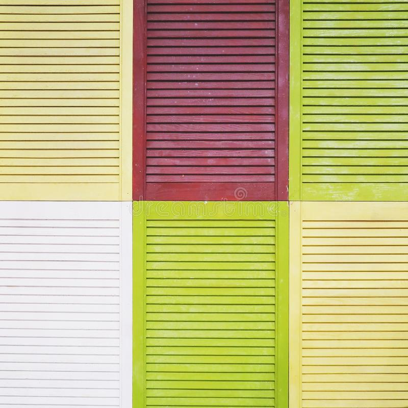 Colored shutters. Great background for website or presentations with the image of colored shutters stock images