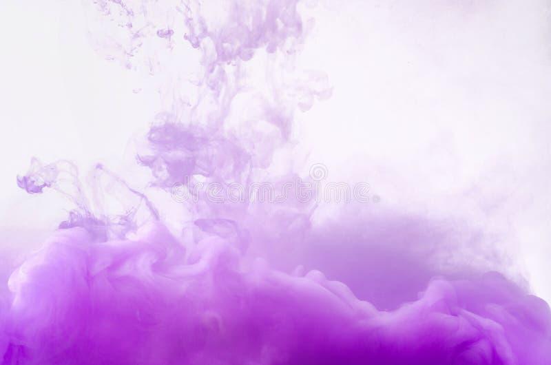Colored smoke swirling underwater stock image