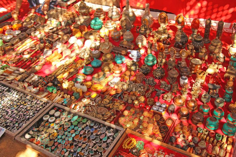 Colored souvenirs are sold on the market in India. Souvenirs gifts Tibet. Ornaments, pens, figurines.  stock photography