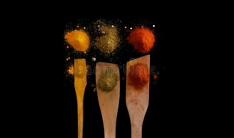 Colored spices on black table stock images