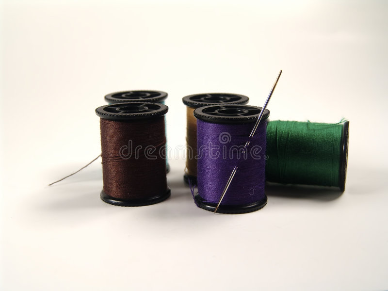 Colored Spools and Needle stock photos