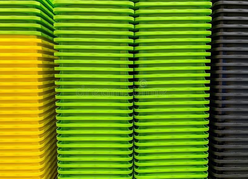Colored stacked plastic boxes stock photo