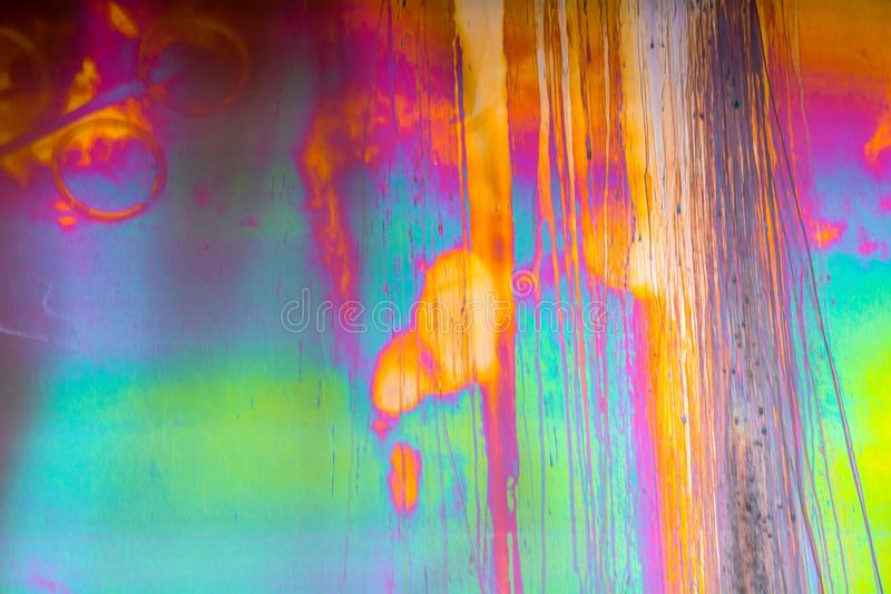 Colored stains on iron surface. The interference of light. Background royalty free stock image