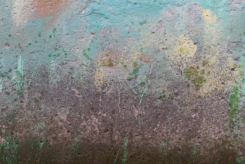 Colored stone texture from old dirty concrete wall of a building. Colored stone background from old dirty concrete wall of a building stock photos