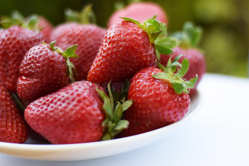Colored strawberries royalty free stock image