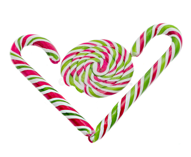 Colored sweet candy, lollipop stick, Saint Nicholas sweets, Christmas candys isolated, white background. Colored sweet candy, lollipop stick, spiral shape, heart royalty free stock image