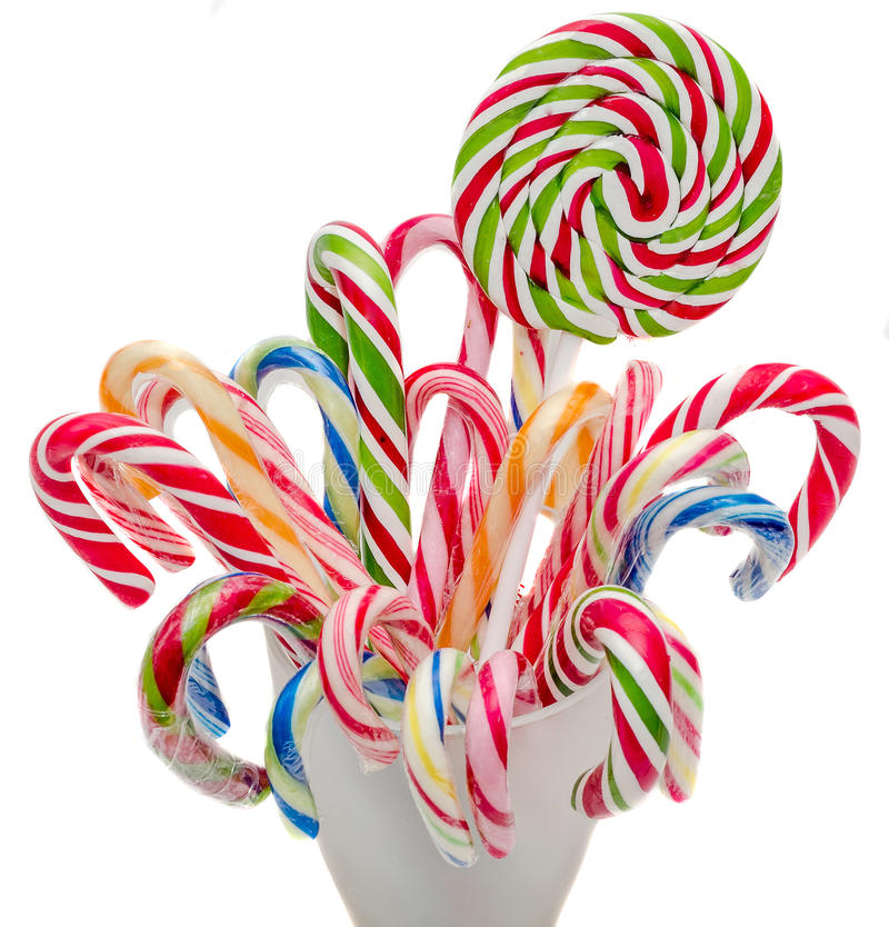 Colored sweet candys, lollipop sticks, Saint Nicholas sweets, Christmas candys isolated, white background. Colored sweet candys, lollipop sticks, spiral shape stock image
