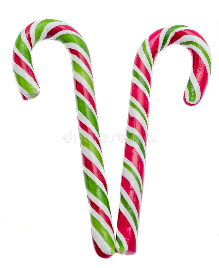 Colored sweet candys, lollipop sticks, Saint Nicholas sweets, Christmas candys isolated, white background. Colored sweet candys, lollipop sticks, spiral shape royalty free stock photo