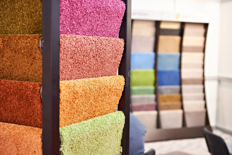 Colored synthetic soft fleecy flooring in store. Colored synthetic soft fleecy flooring in the store stock images