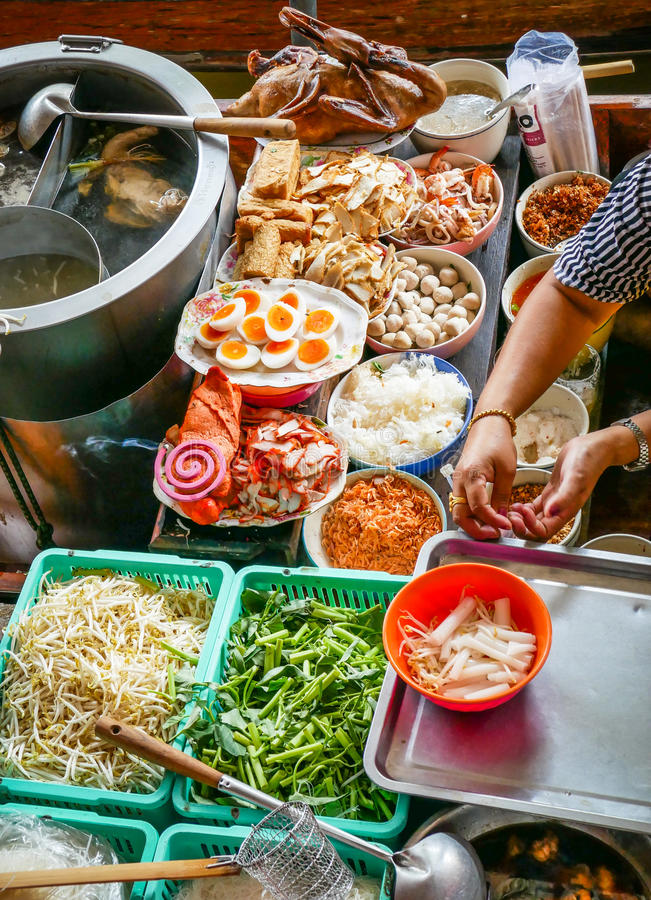 Colored thai food in floating market, food seller in Thailand. Typical thai food background stock image