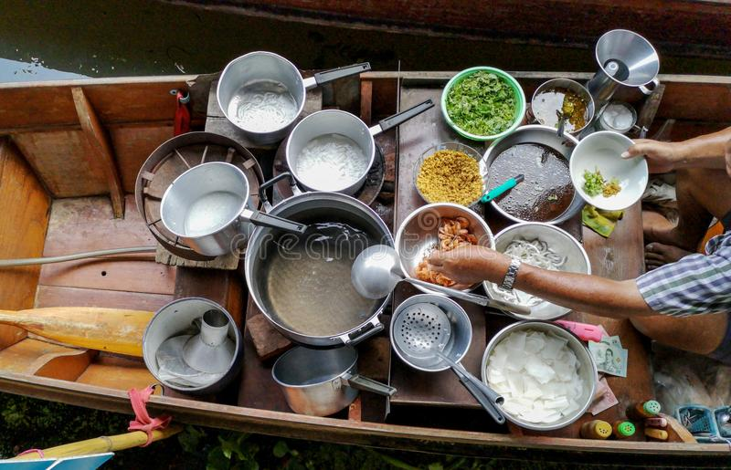 Colored thai food in floating market, food seller in Thailand, typical thai food background. Damnoen Saduak Floating Market royalty free stock photo
