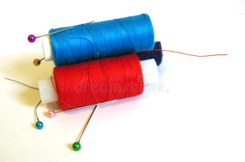 Colored thread coils on white background, sewing, royalty free stock image