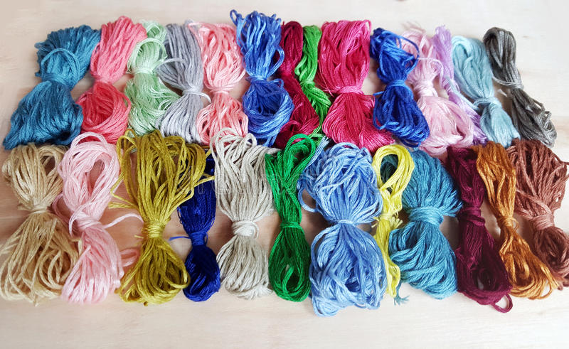 Colored thread for embroider a tapestry. Sewing kit royalty free stock photos