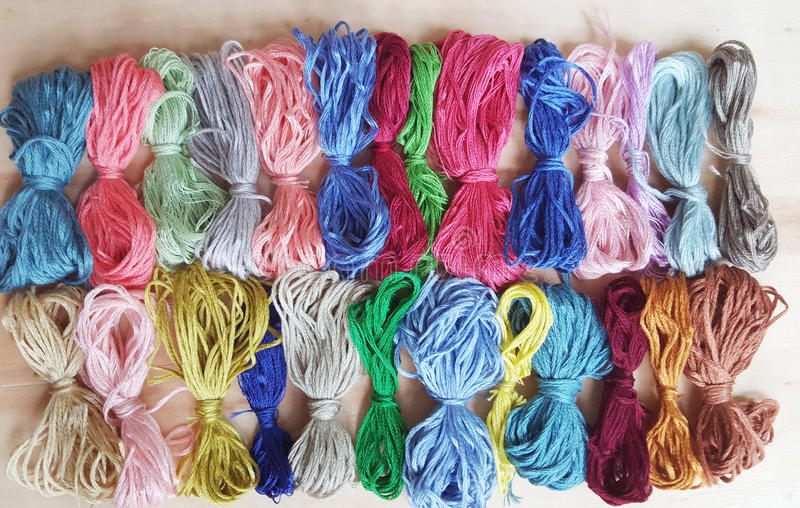 Colored thread for embroider a tapestry. Sewing kit stock photos