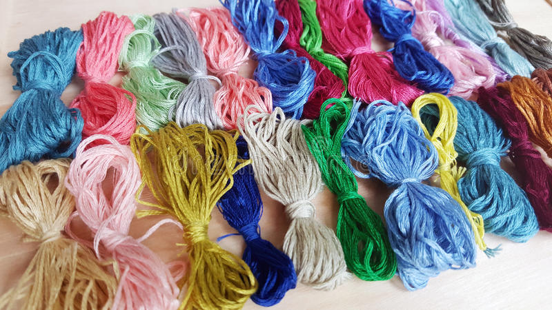 Colored thread for embroider a tapestry. Sewing kit stock images