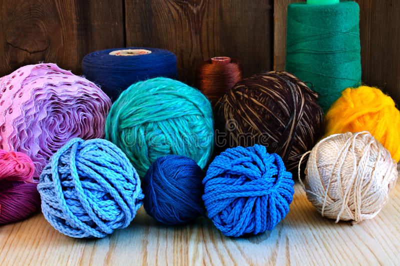 Colored thread and yarn. On the wooden table stock photos