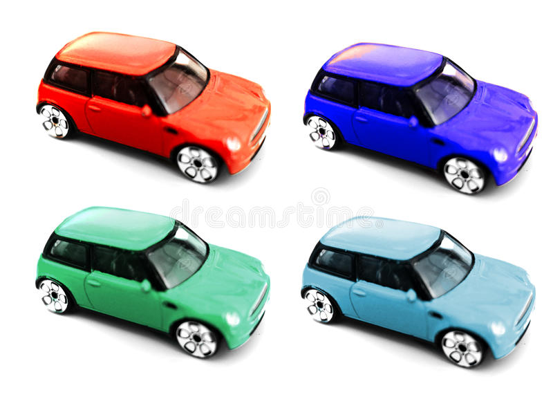 Colored toy car miniature models. Four colored miniature cars of the same type isolated on a white background stock photo