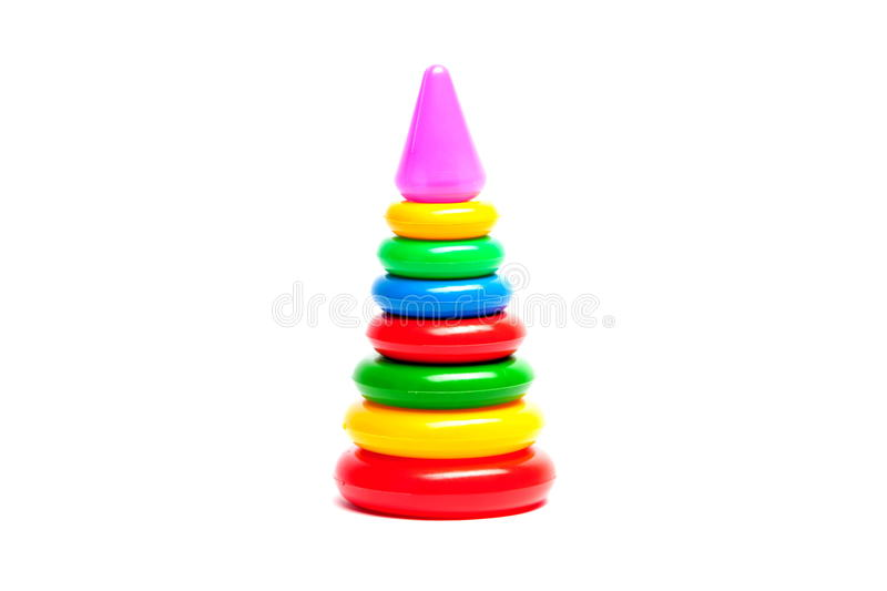 Colored toy pyramid. On a white background royalty free stock photos